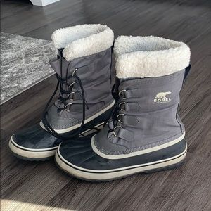 Gray and black Sorel waterproof boots